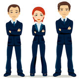 Confident Business Team. Confident team of three business people partners standing with arms crossed Stock Images