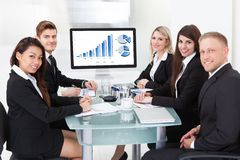 Confident business team at desk Royalty Free Stock Photos