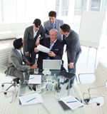 Confident business team discussing a contract Stock Image