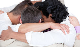 Confident business team hugging each other Royalty Free Stock Photography