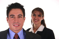 Confident business team II. Business team man in front and woman behind Royalty Free Stock Image