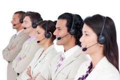 Confident business team lining up with headset on Royalty Free Stock Photography