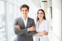 Confident business team of man and woman standing with crossed hands, team spirit concept, couple of success business people ready royalty free stock image