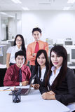 Confident business team at office Stock Photos