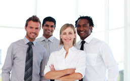 Confident business team smiling at the camera Stock Image
