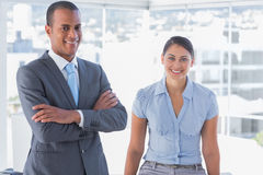 Confident business team smiling at camera Royalty Free Stock Images