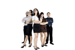 Confident business team standing in studio Royalty Free Stock Photo
