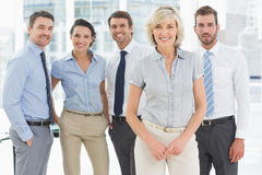 Confident business team together in office Stock Image
