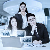 Confident business team and virtual chart Royalty Free Stock Image