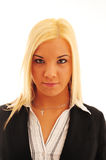 Confident Business Woman. Young confident business woman with blonde hair in a stylish dark suit on a white background stock photography