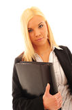Confident Business Woman. Young confident business woman with blonde hair in a stylish dark suit on a white background stock photos