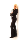 Confident Business Woman. Young confident business woman with blonde hair in a stylish dark suit on a white background royalty free stock images