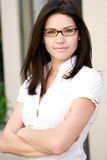 Confident Business Woman. A confident business woman wearing glasses looks confidently toward the camera Stock Image