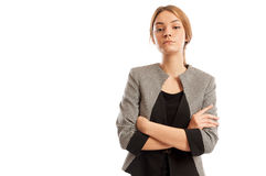 Confident business woman with arms crosses and head up Stock Photography