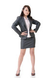 Confident business woman. Of Asian, full length portrait on white background Stock Photo