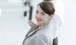 Confident business woman on blurred background office. Royalty Free Stock Image
