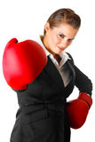 Confident business woman with boxing gloves Stock Photo