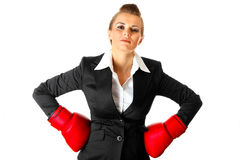 Confident business woman with boxing gloves Royalty Free Stock Photos