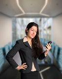 Confident business woman with cell phone. Pretty brunette business woman with cell phone in business meeting Stock Photos