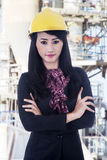Confident business woman at construction site. Confident business woman with arms crossed at construction site Royalty Free Stock Photos