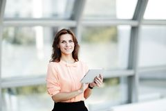 Confident business woman with digital tablet on blurred office background. Photo with place for text Stock Photo