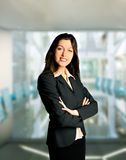 Confident business woman with folded arms Stock Image