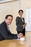 Confident business woman giving presentation. In a boardroom Stock Photos
