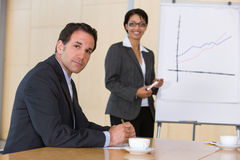 Confident business woman giving presentation Stock Image