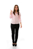 Confident business woman giving thumbs up Stock Photo