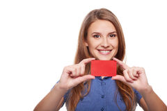 Confident business woman in glasses showing blank credit card Stock Photography