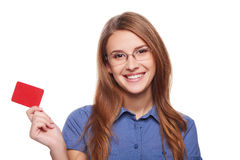 Confident business woman in glasses showing blank credit card Stock Image