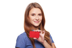 Confident business woman in glasses showing blank credit card Royalty Free Stock Image