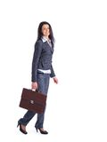Confident business woman going and holding a brief Royalty Free Stock Photography