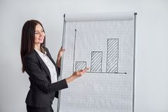 Confident business woman happy with her growth and success. stock photos