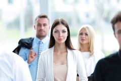 Confident business woman among his colleagues Stock Photo
