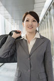 Confident business woman holding briefcase in modern city Royalty Free Stock Photography
