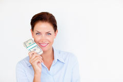 A confident business woman holding currency Royalty Free Stock Photography