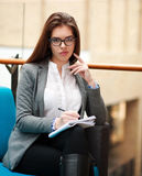 Confident business woman with notebook in office Royalty Free Stock Photo