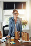 Confident business woman at office Stock Photo