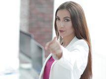 Confident business woman pointing finger forward. Concept of purpose.confident business woman pointing finger forward Stock Photo