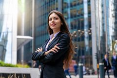Confident business woman portrait in the City of London. Businesswoman standing cross-armed, proud and successful in suit stock image