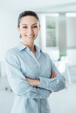 Confident business woman posing with arms crossed Stock Image