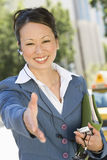 Confident Business Woman Ready For A Deal. Happy confident business woman with open hand ready for a deal Royalty Free Stock Photo