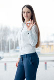 Confident business woman showing ok sign Stock Photo