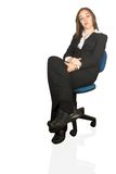 Confident business woman sitting on a chair Stock Photography