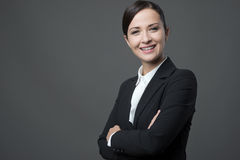 Confident business woman smiling with arms crossed Royalty Free Stock Photography