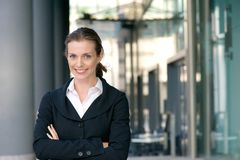Confident business woman smiling with arms crossed Stock Photo