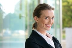 Confident business woman smiling Stock Photo