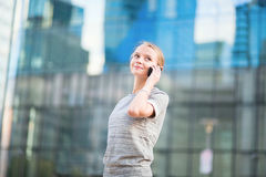 Confident business woman speaking on the phone. Young confident business woman speaking on the mobile phone Stock Photo