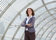 Confident business woman standing with arms crossed Stock Photos